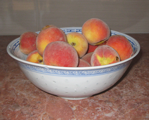A bowl of home-grown peaches